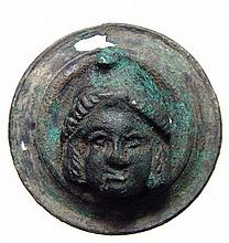 Roman bronze rondel with the head of the god Men