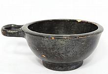 An Apulian black glazed side handled cup