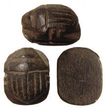 An Egyptian basalt heart scarab, Late Period