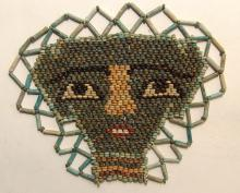 Beautiful Egyptian faience beads shaping a face 'mask'
