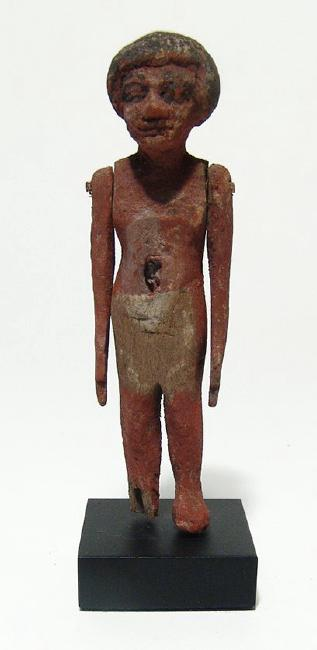 Egyptian wood painted figure of a man, Middle Kingdom