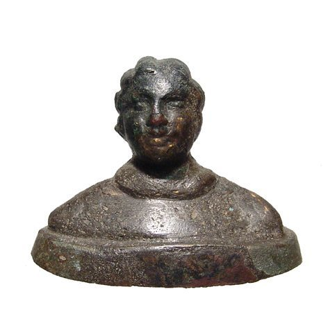 A finely detailed Hellenistic bronze bust of a woman