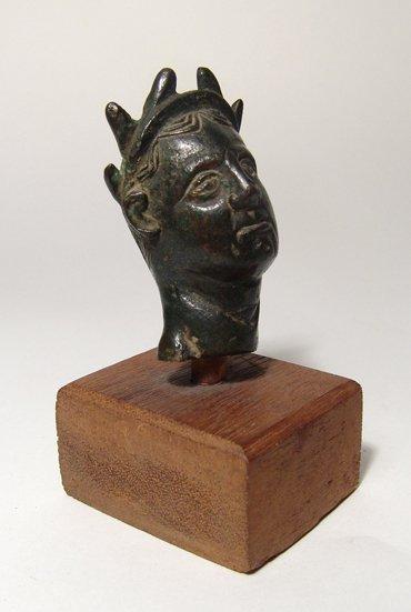 A Roman bronze votive head of an emperor or priest