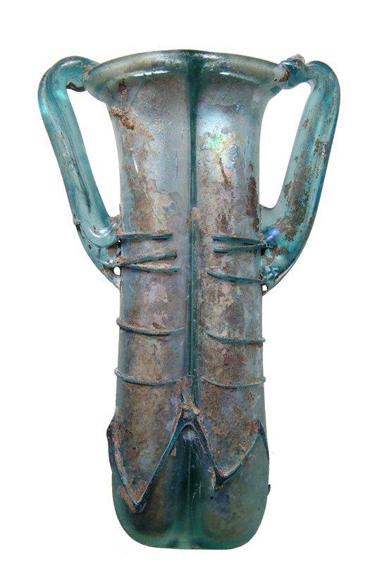 An attractive Roman blue glass double-unguentarium
