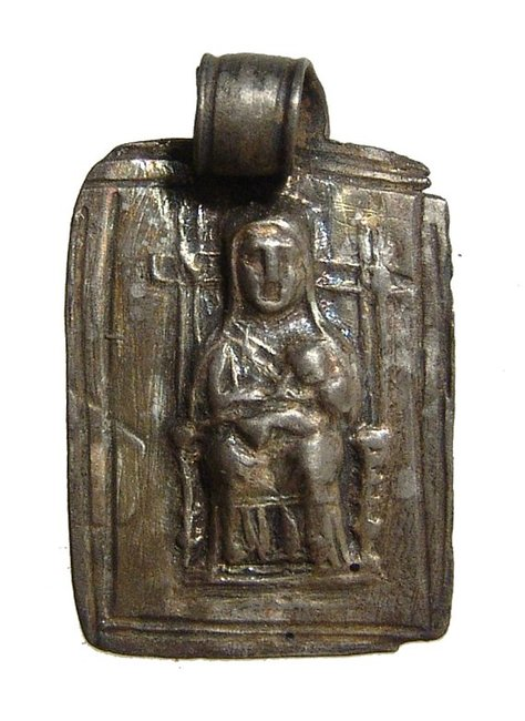 A Roman silver pendant depicting a mother goddess