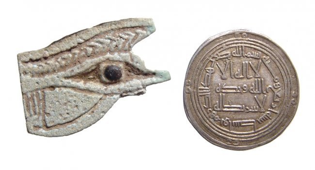 Mixed lot - Eye of Horus amulet and Islamic silver Dirhem