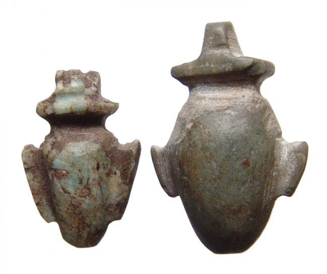 A pair of Egyptian stone 'ib' or heart amulets, Late Period