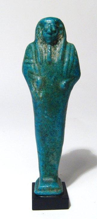 A fantastic Egyptian bright turquoise-blue faience ushabti