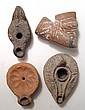 3 ancient ceramic lamps and a pipe