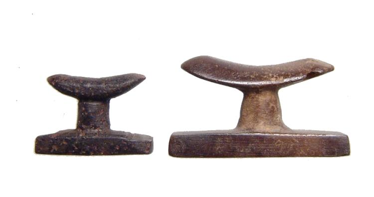 A pair of Egyptian stone headrest amulets