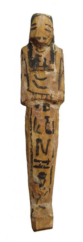 An Egyptian painted wood ushabti, Late New Kingdom