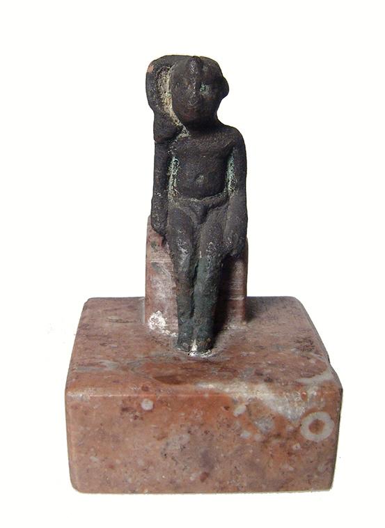 Egyptian bronze figure of seated Harpokrates