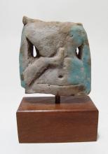 An Egyptian faience torso from a concubine figure