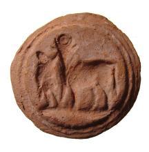 An Egyptian terracotta bread stamp