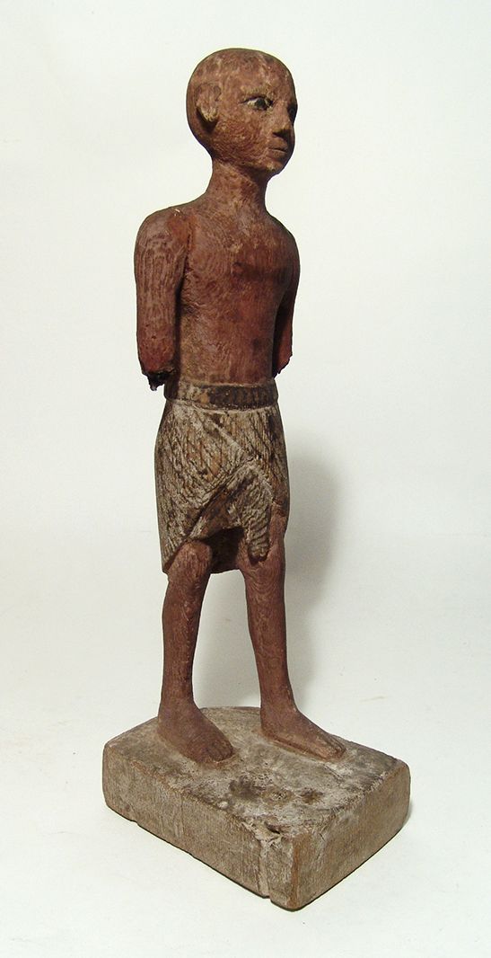 A large Egyptian wooden figure of a man
