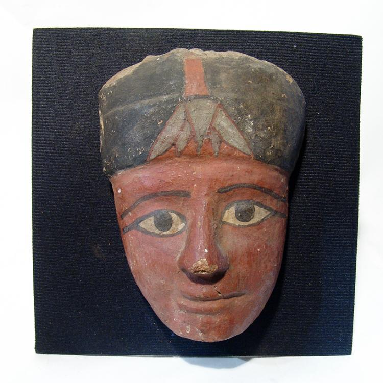 A well-preserved Egyptian wooden 'mummy' mask
