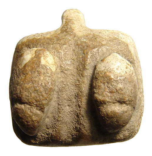 Rare limestone fertility amulet of female breasts