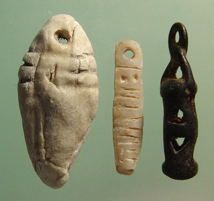 Levantine bronze, stone and shell amulets