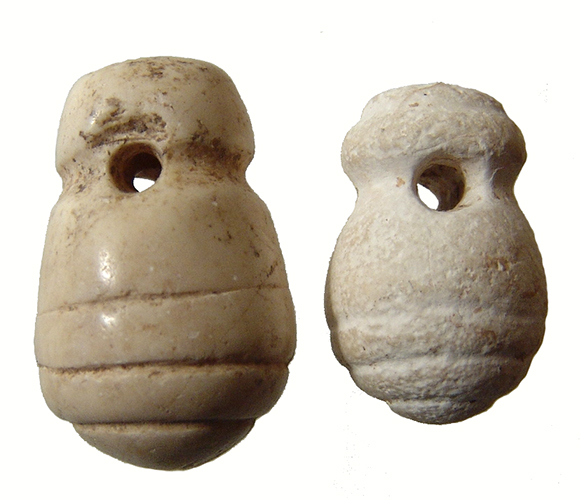 Pair of carved crème marble beads or pendants
