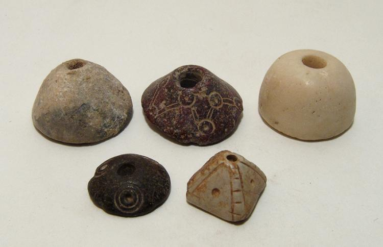 A group of 5 stone spindle whorls