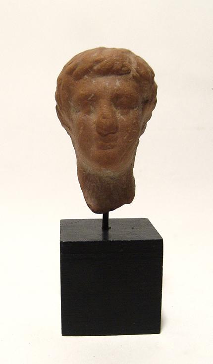 A Greek terracotta head of a man