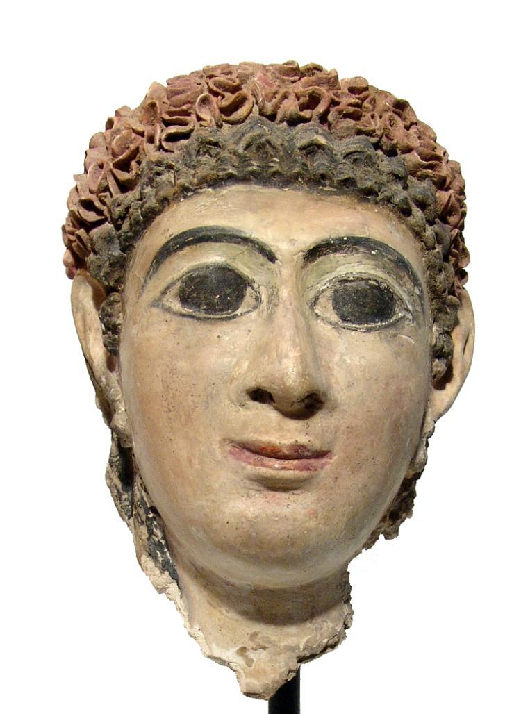 A beautiful Roman stucco mask of a woman, Egypt