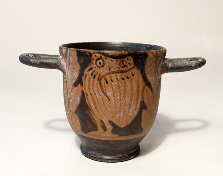 A handsome Greek red-figure owl skyphos