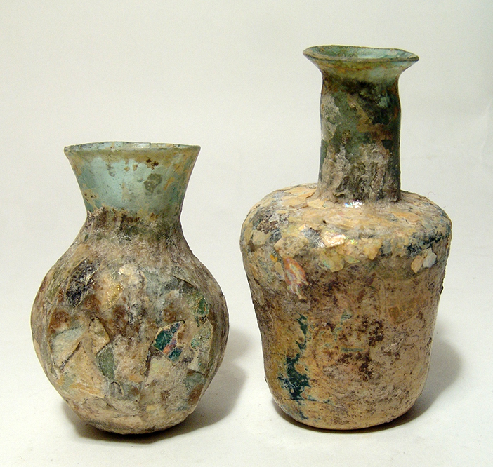 A pair of blue-green Late Roman glass vessels