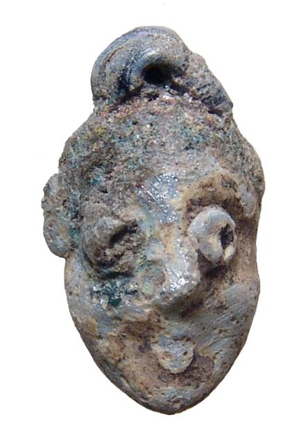 Phoenician multicolored glass face bead