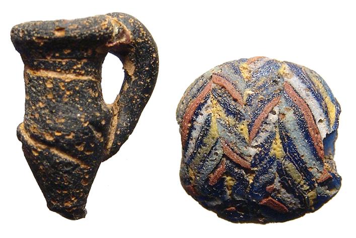 A Roman mosaic glass bead and glass juglet