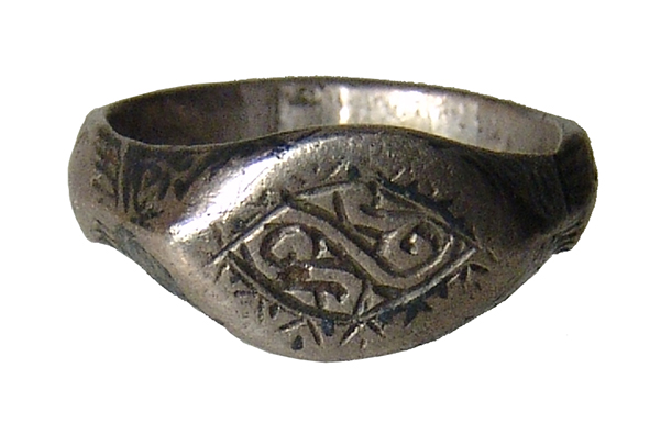 A Medieval silver ring with decorative bezel