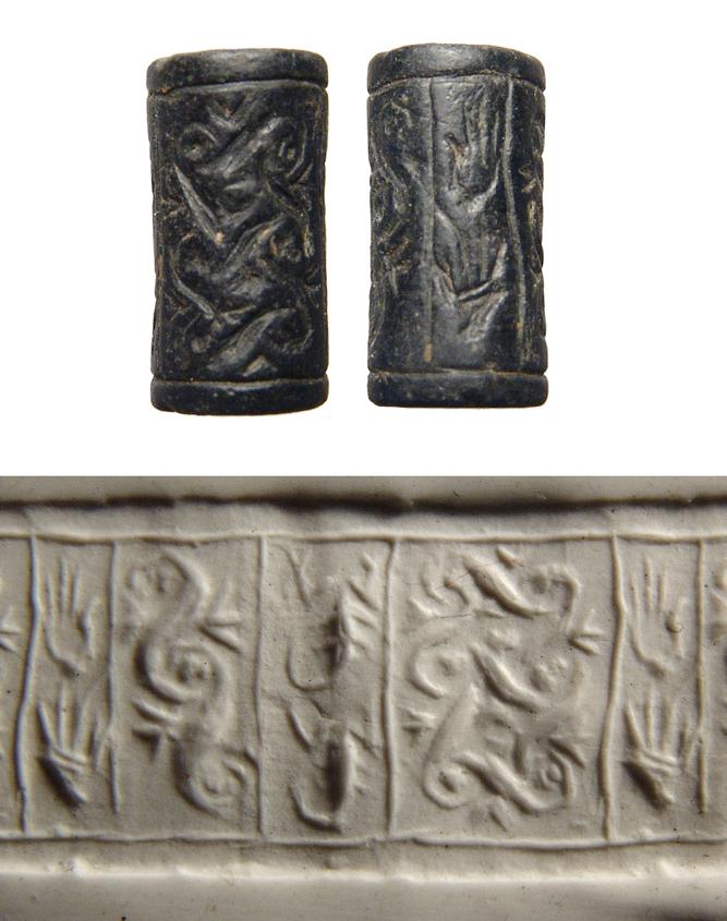 Old Syrian black serpentine cylinder seal