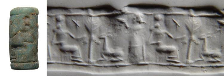 A Levantine green glass cylinder seal