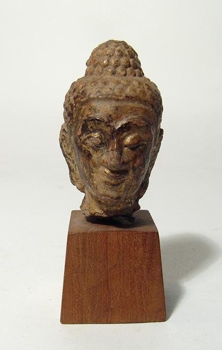 A gilded terracotta Buddha head, Thailand