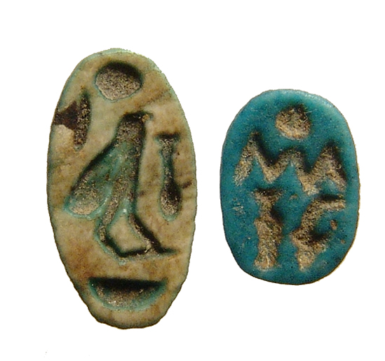 An Egyptian blue faience scarab and a scaraboid