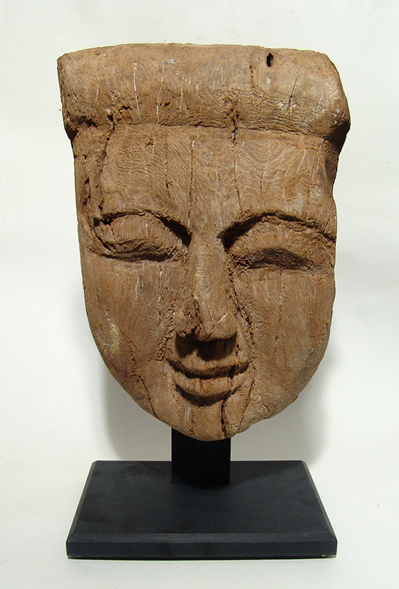A large Egyptian wooden 'mummy' mask