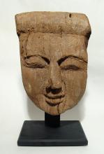 A large Egyptian wooden 'mummy' mask