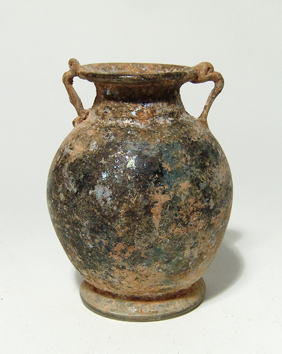A Roman colorless glass two-handled bottle