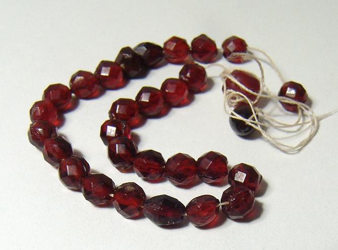 A strand of antique almandine garnet beads