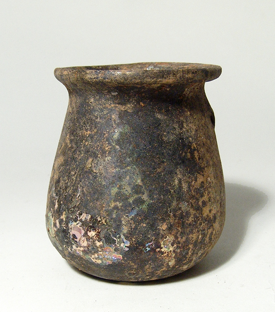 A Roman pale green glass goblet