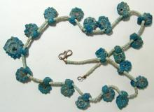 Egyptian faience necklace with rosette pendants