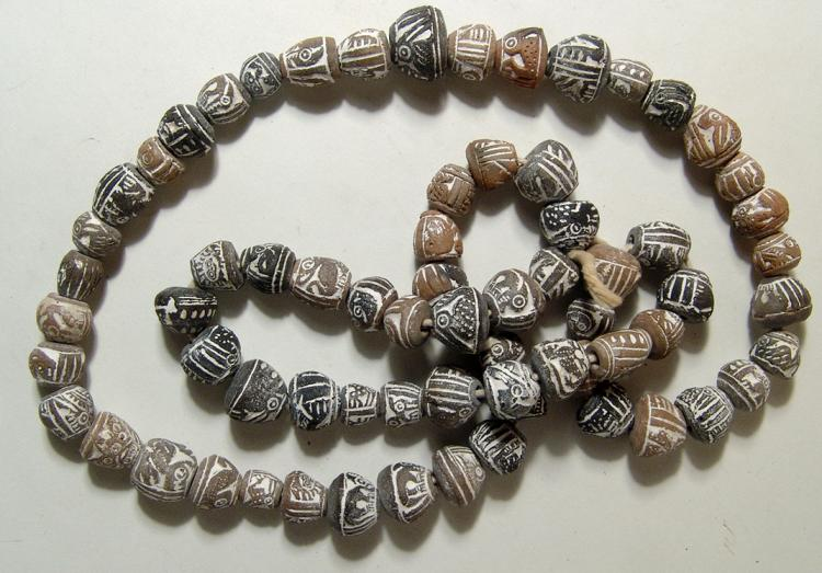 Strand of Precolumbian terracotta beads, Ecuador