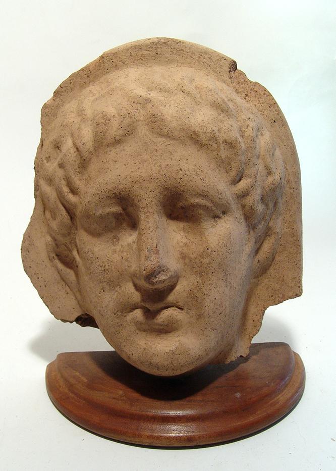An Etruscan terracotta male votive head