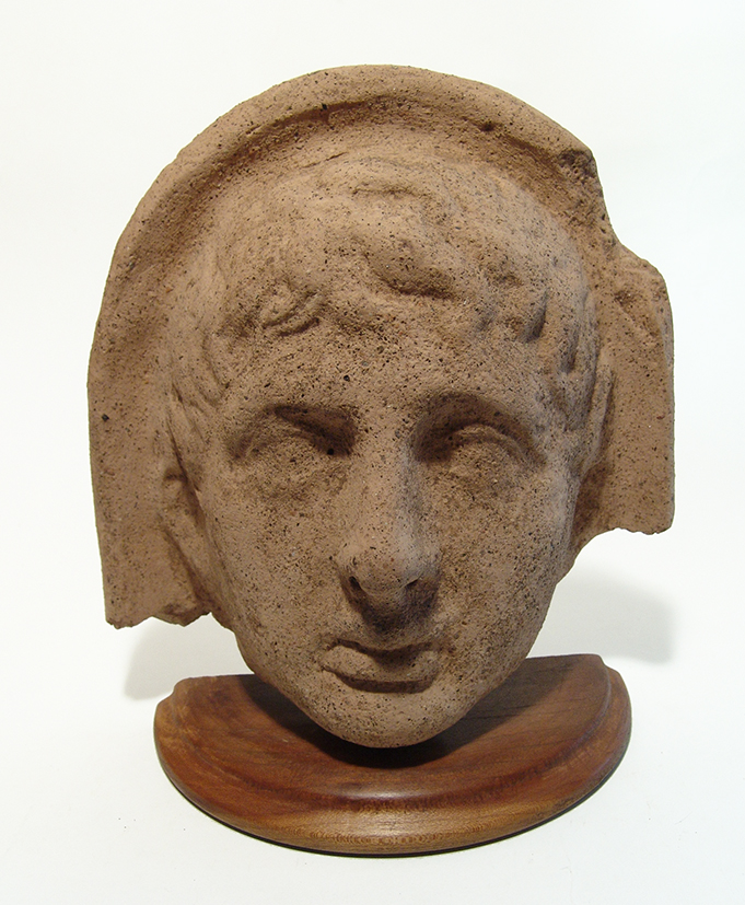 An attractive Etruscan terracotta male votive head