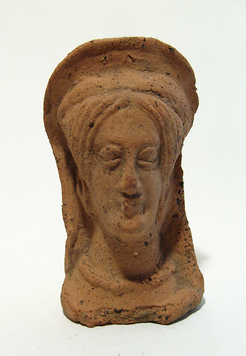 An Etruscan terracotta votive veiled female head