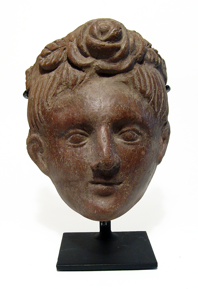 A very nice Etruscan terracotta mask of a youthful male