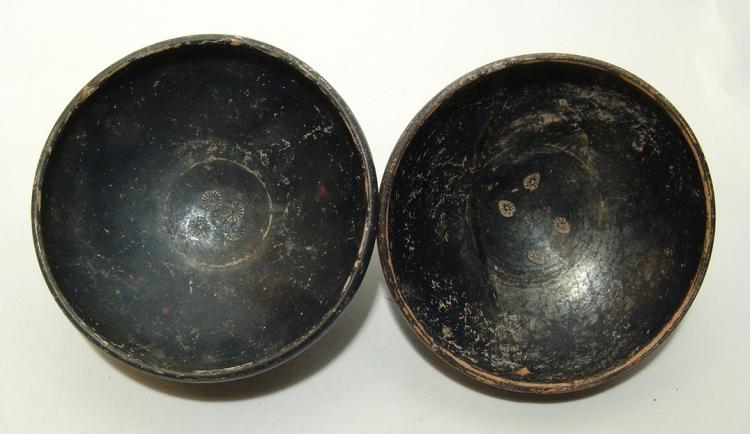A nice pair of Campanian black-ware footed bowls