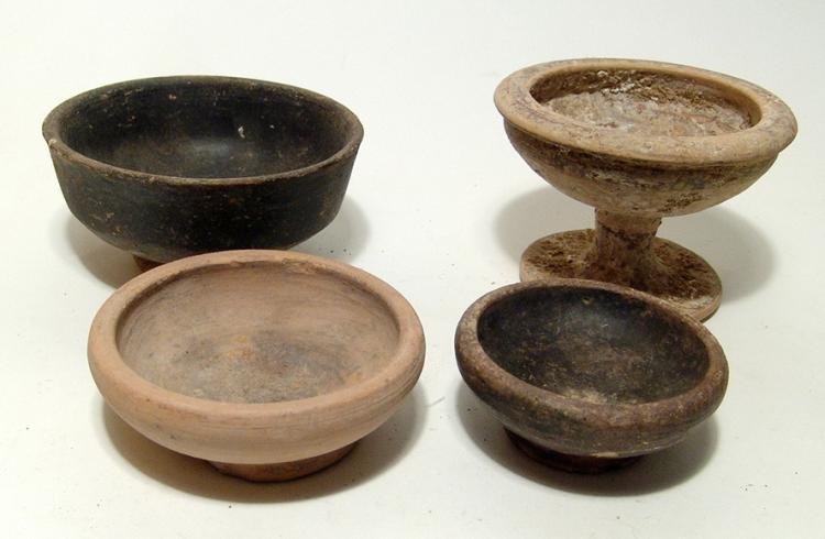 A group of four ancient Greek bowls