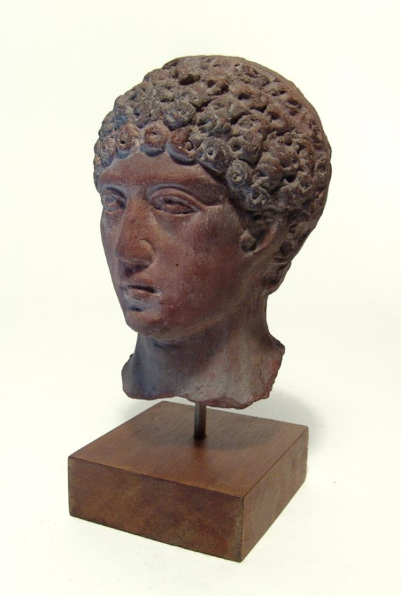 A handsome Romano-Etruscan head of youth