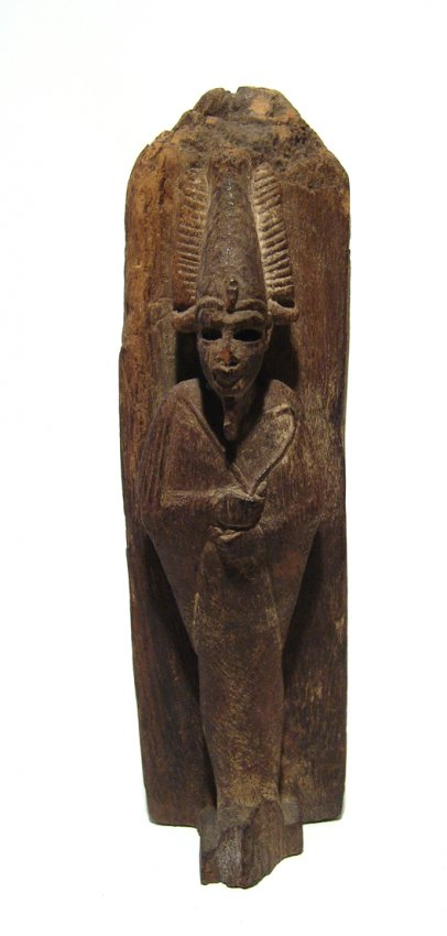 An extraordinary Egyptian wood obelisk with Osiris